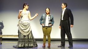 Kat White as Geraldine Moodie, Lisa Nasson as Camera, and Louis Adams as John Douglas Moodie